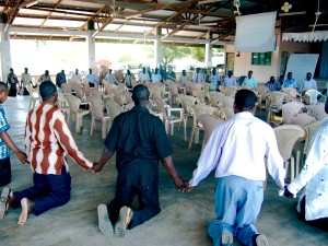 Childers praying with West Africa Leaders